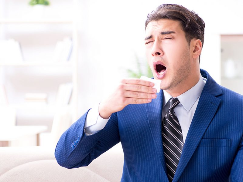 Sick employee staying at home suffering from flue