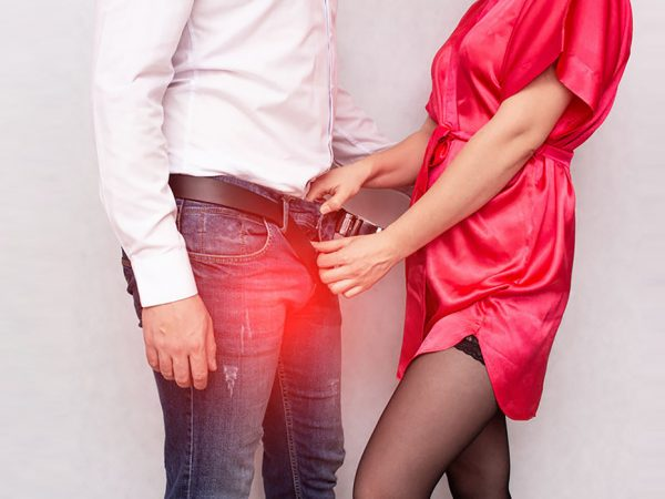 A girl unbuttons her pants in a contagious male sexually transmitted infection, sexually transmitted infections, protection, contact